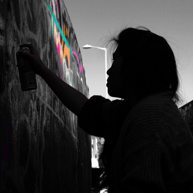 Mish Chang painting in the Leake Street tunnel as part of the filming for the Femme Fierce kickstarter video