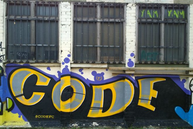 Code tag on the canalside near to the tower