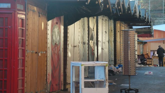 Rows of sheds with art from 'Girl'