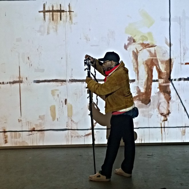 A photographer takes pictures in the 'La Carne' room