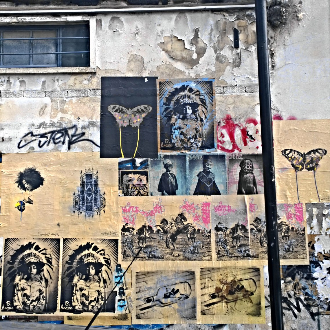 A wall of paste ups by street artist Donk on Toynbee Street