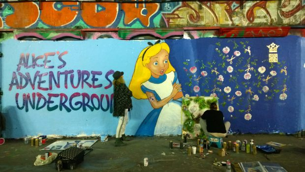 The almost completed mural with Femme Fierce curator Ayaan Bulale giving a had with the final touches