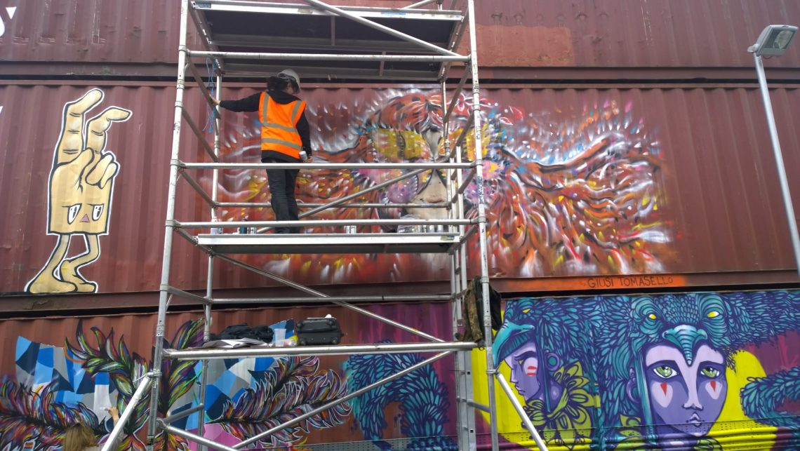 Scaffolding up on the outside of the park with work from Giusi Tomasello, Azarro Amoy and Elno