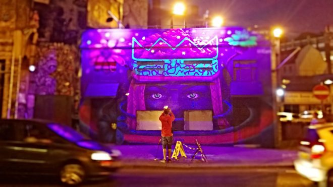 Zina's mural with assistance from Amara Por Dios glowing on a Shoreditch night