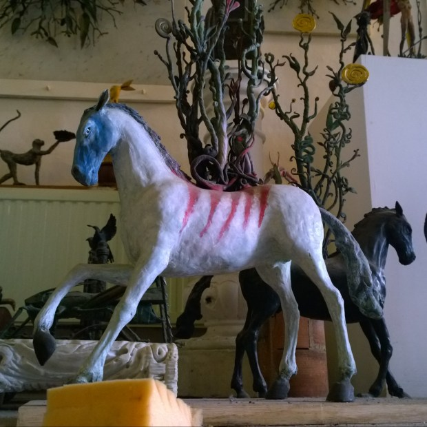 Model horse, the same character can be seen often on paste ups