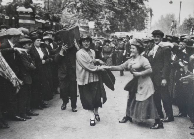 Minnie Lansbury being congratulated on the way to  Poplar Town Hall prior to being sent to Holloway