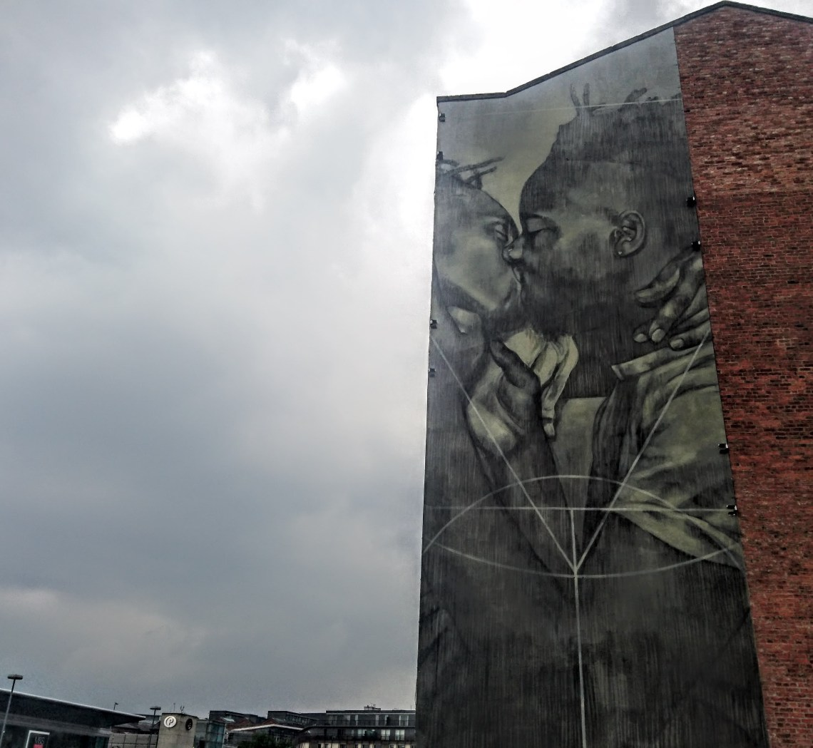 Mural by Faith47 overlooking the canal in Manchester. Created as part of the Cities of Hope Street Art festival in Manchester.