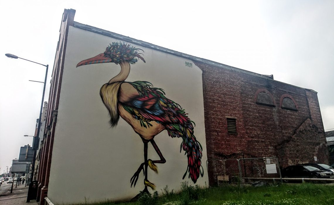 The Guardian of Ancoats street art mural by Mateus Bailon in the Northern Quarter in Manchester