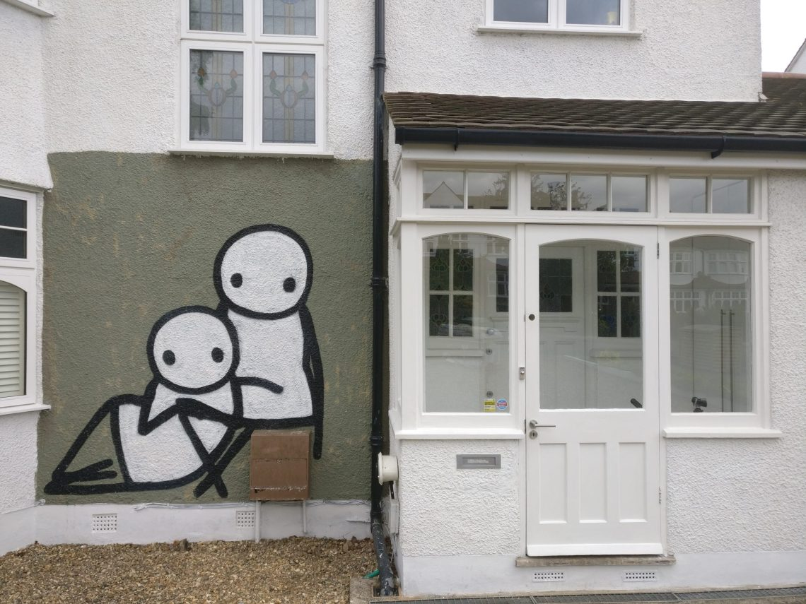 Murals by Stik on the side of a house in Dulwich. The murals were curated by Ingrid Beazley