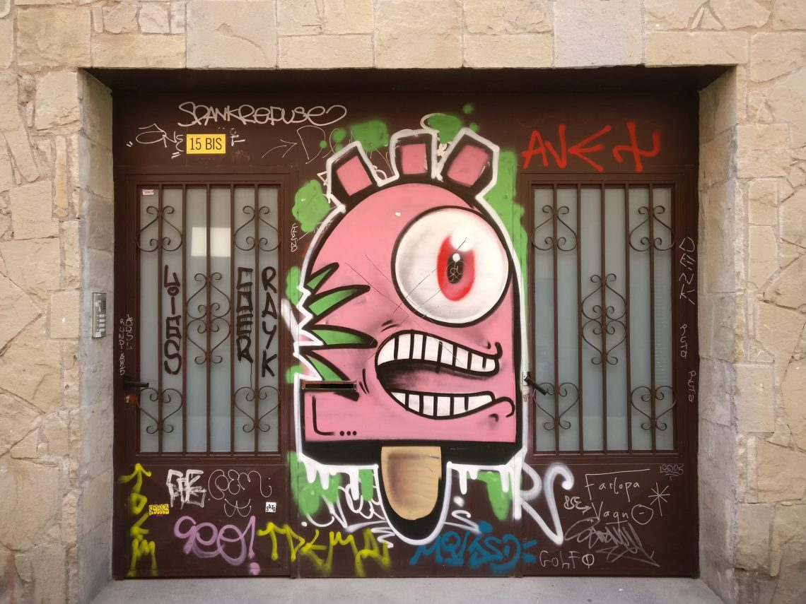 A giant pink popsicle painting by street artist Konair in Barcelona