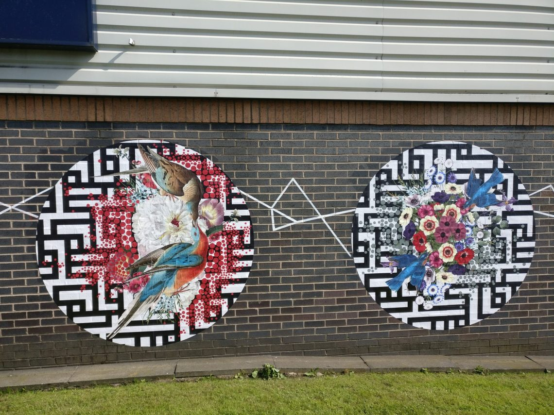 Art by the artist Alexandra Gallagher on the side of Graham and Browns in Blackburn