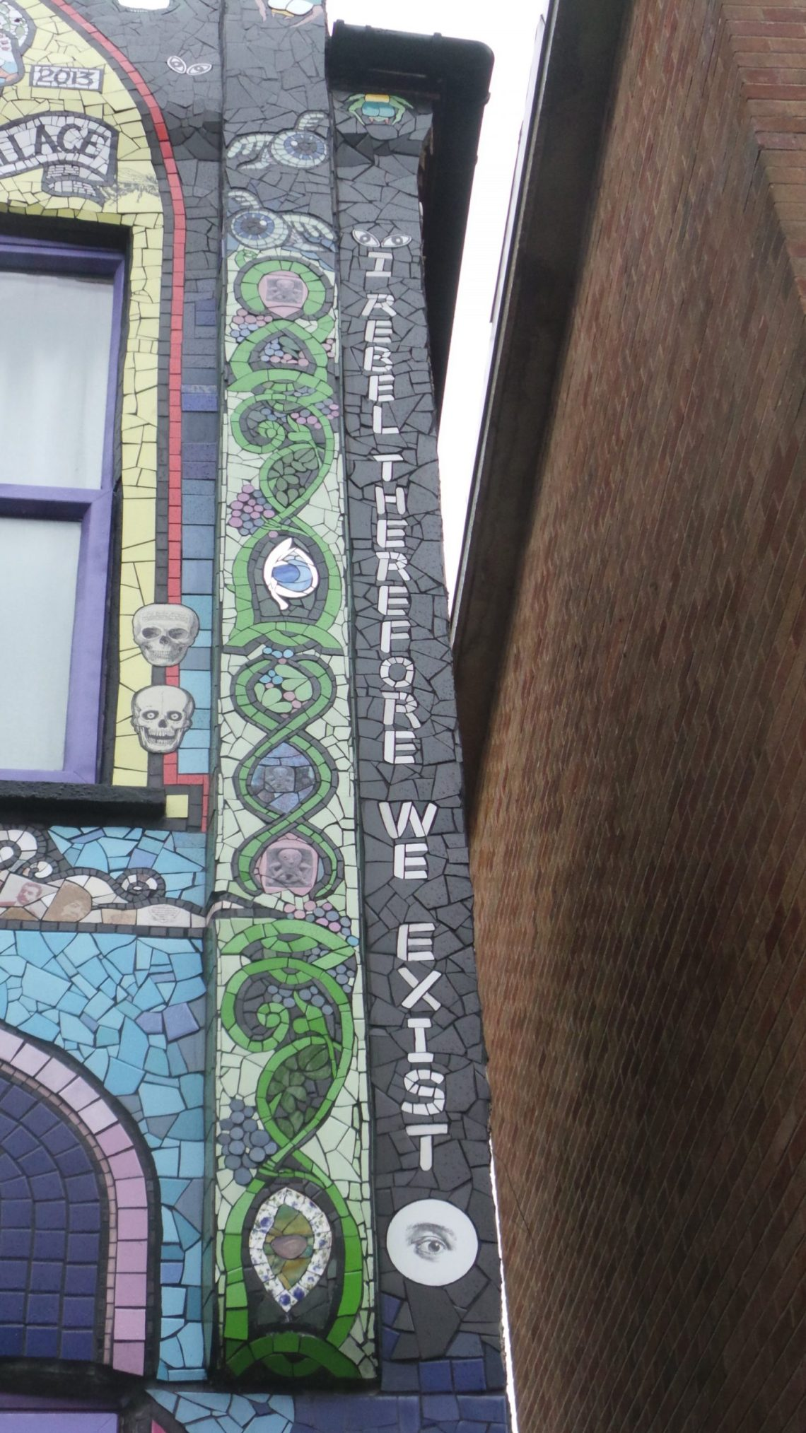 A mosaic double helix on the front of the mosaic house by Karen Francesca