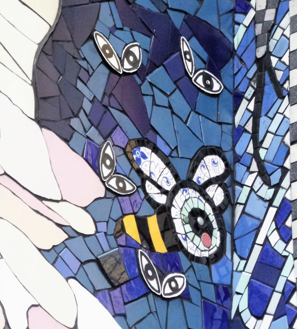 Butterfly eyes by Nevanka Pavic on the front of the mosaic house