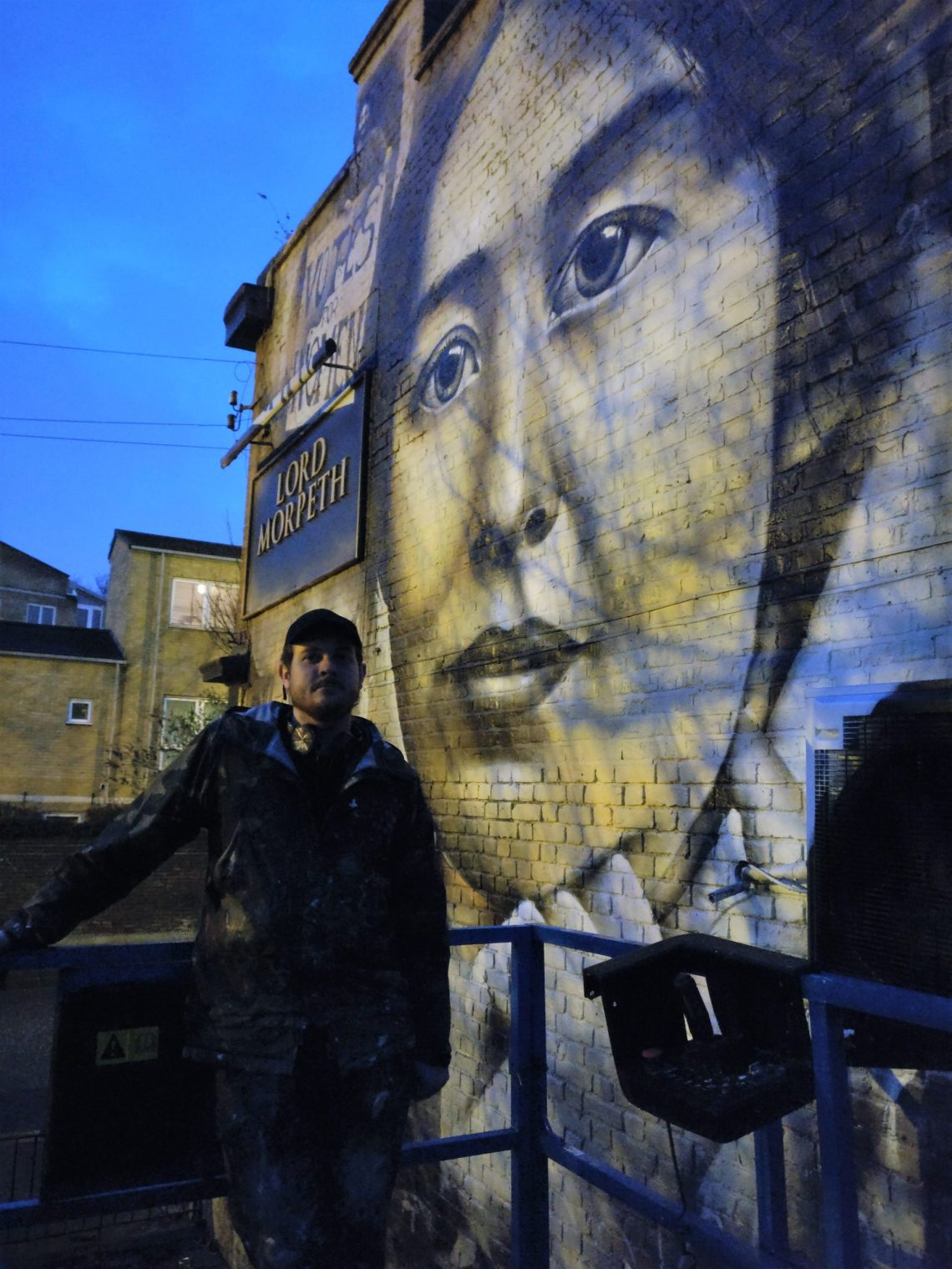 jerome davenport by his mural of Sylvia Pankhurst