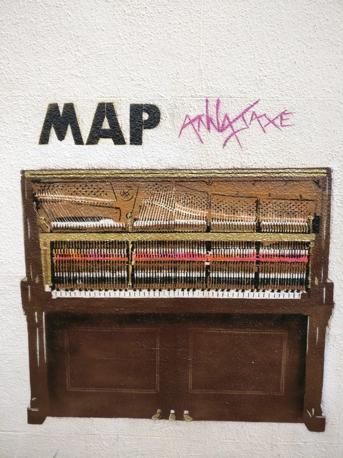 A 12 layer stencil of a piano by Anna Jaxe outside the MAP studio is Kentish Town