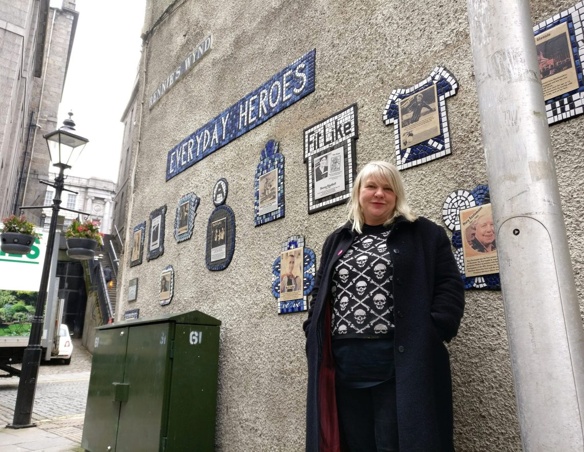 Carrie Reichardt in Aberdeen next to her 'Everyday Heroes' Mural