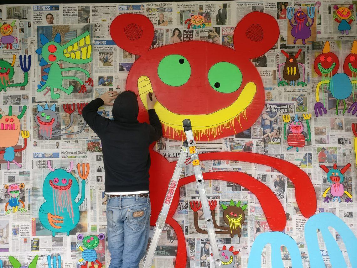 Bortysk Leer working on his mural in Aberdeen
