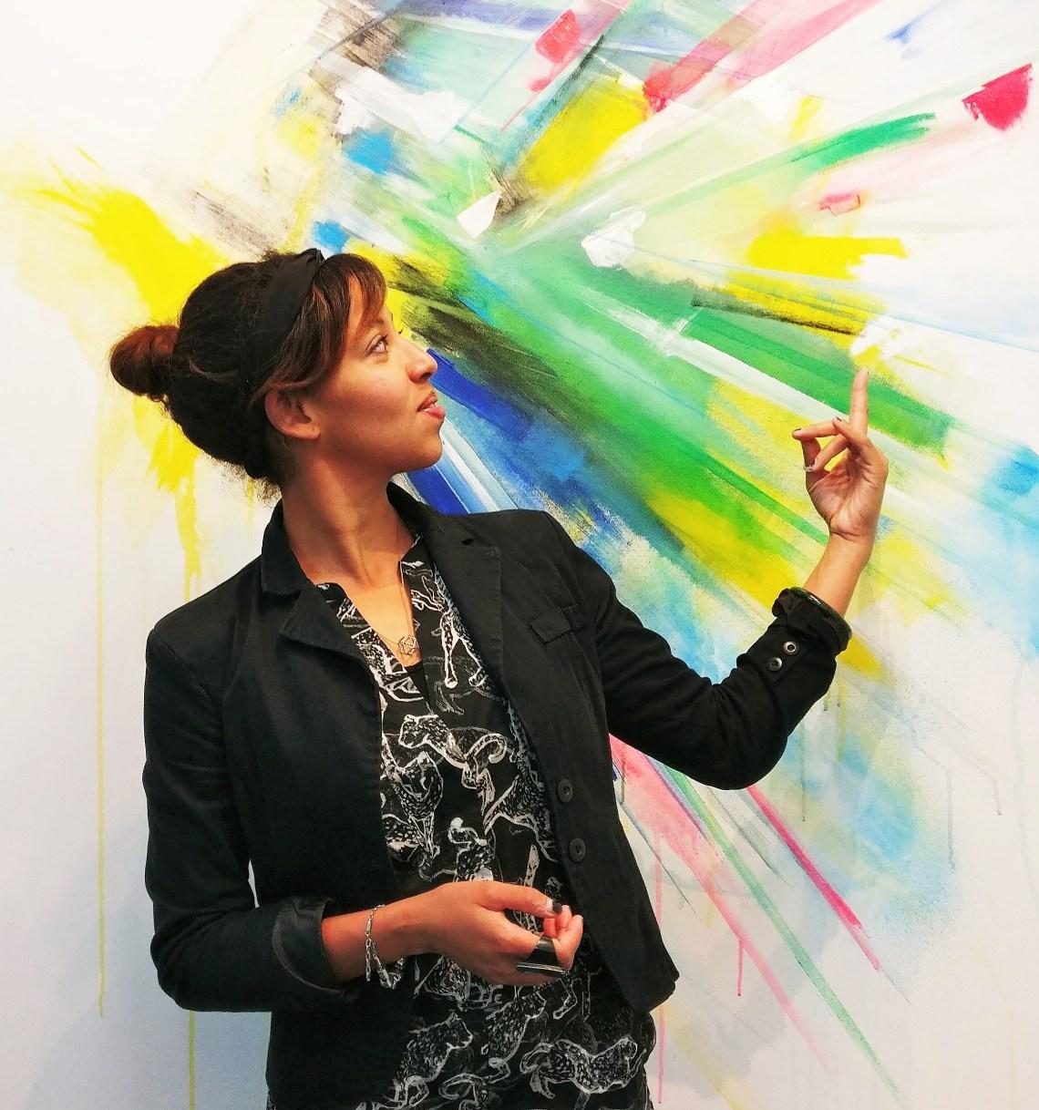 Laura Benetton by an artwork in the Wimbledon Art Studios