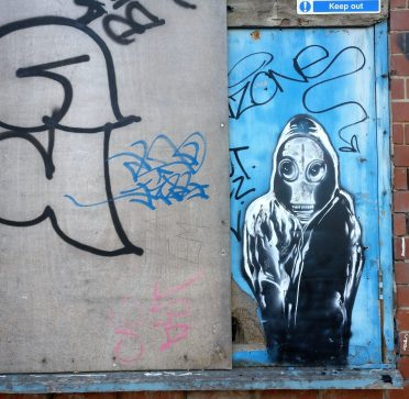 Work from Sickoart can be seen around the outside of the abandoned buildings