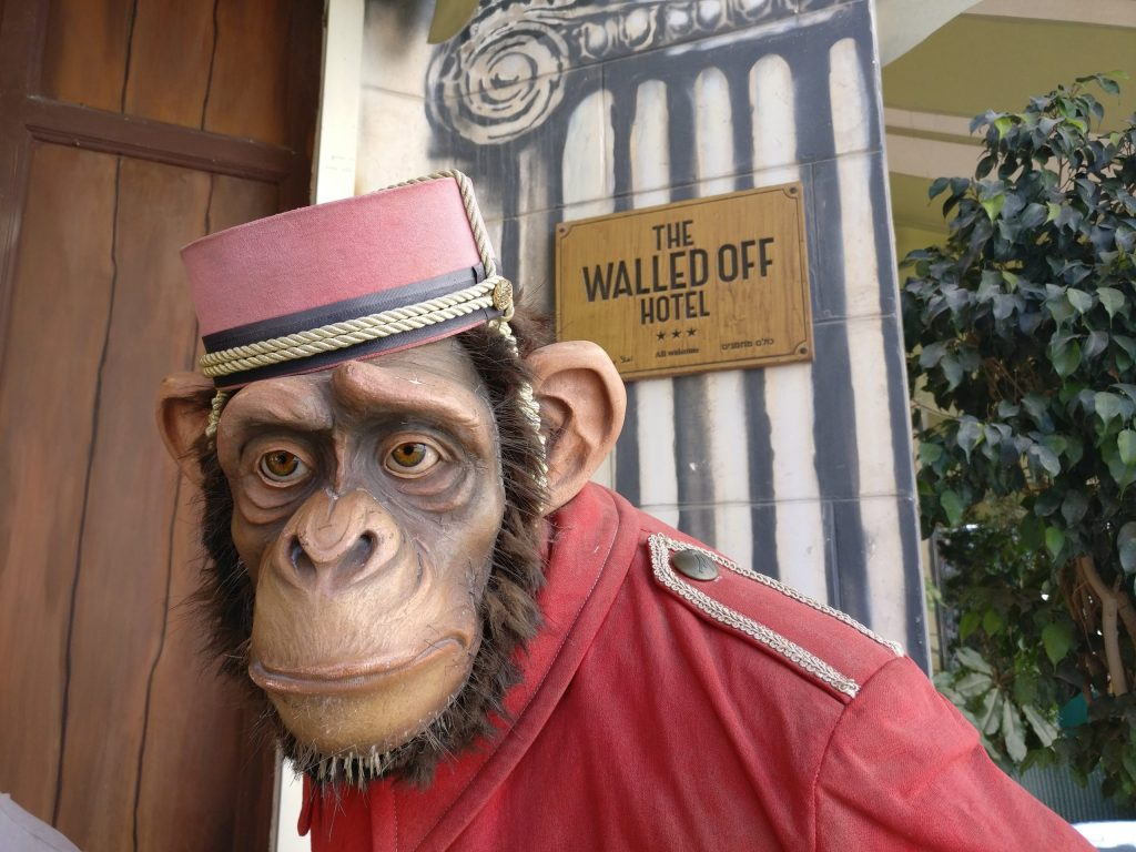 A statue of an Ape Bellhop stands outside the Walled Off Hotel in Bethlehem