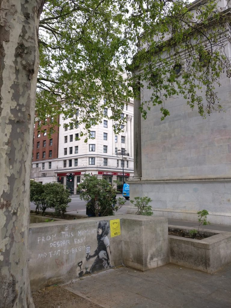 Banksy mural next to the Marble Arch