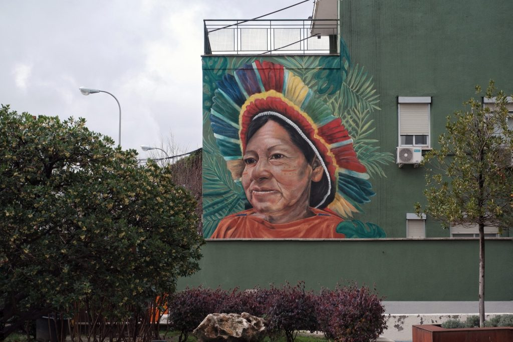 Past, Present and Future. A street art mural by Jorge Rodriguez Gerada in Madrid