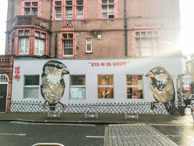 Two sparrows, one male and one female has been painted as a mural by Louis Masai