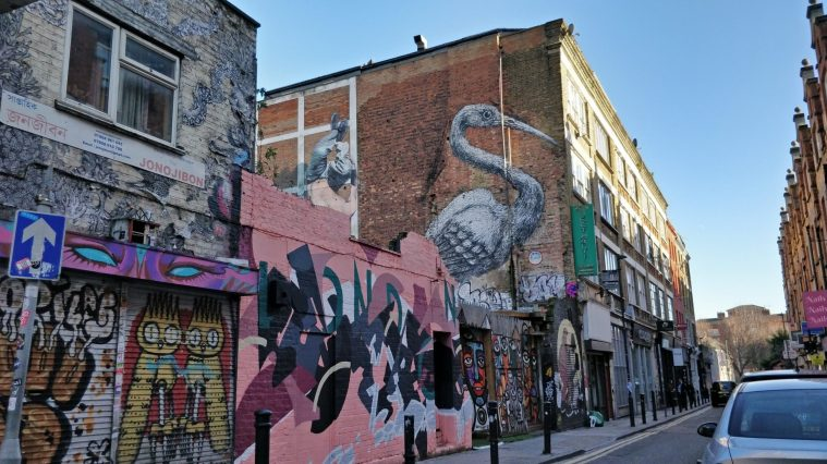Street art mural of a crane from ROA on Hanbury Street near Brick Lane