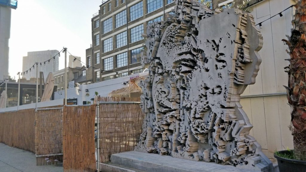 A sculpture from Vhils inside the yard of the Truman Brewery