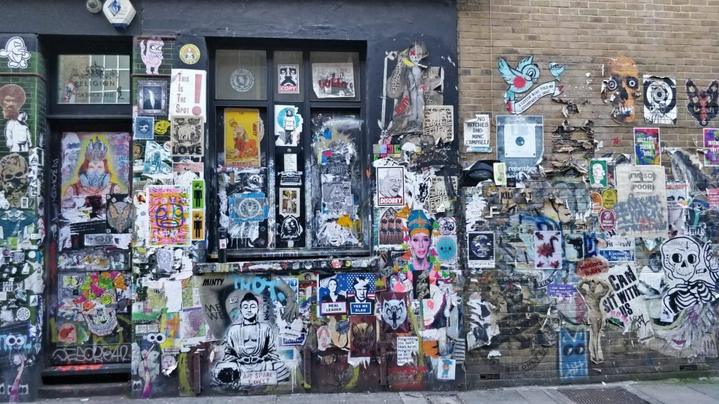 Paste ups and graffiti on Buxton Street near Brick lane