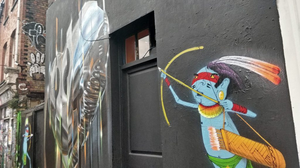 One of Cranio's street art characters ready to fire an arrow on Hanbury Street