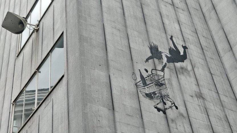 Banksy's Falling Shopper can be found on a building on Bruton Lane in Mayfair