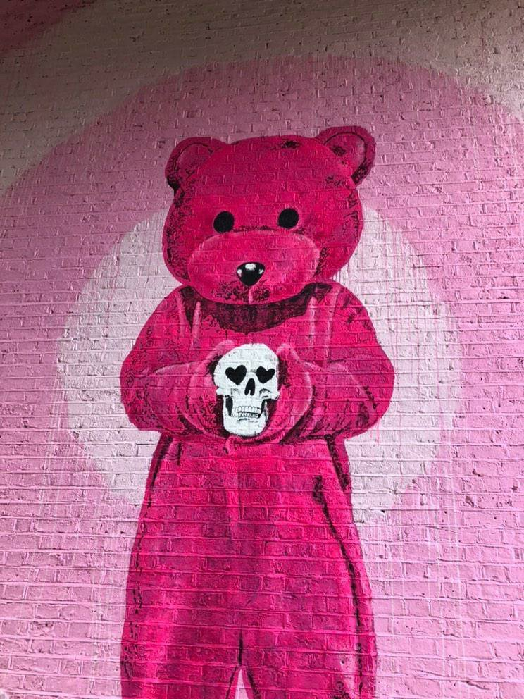 The completed pink bear painted on a wall in Shoreditch