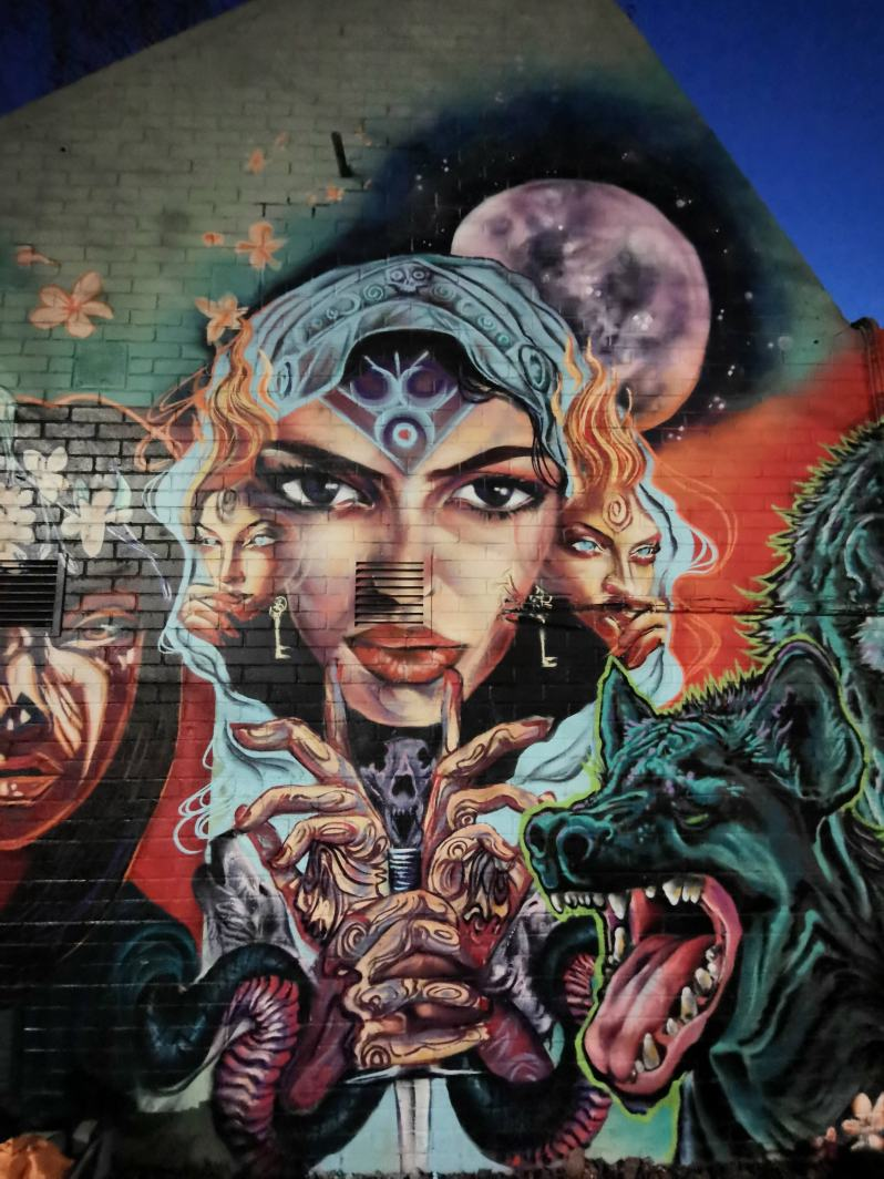 Section of wom collective wall by Van Jimmer in Brixton