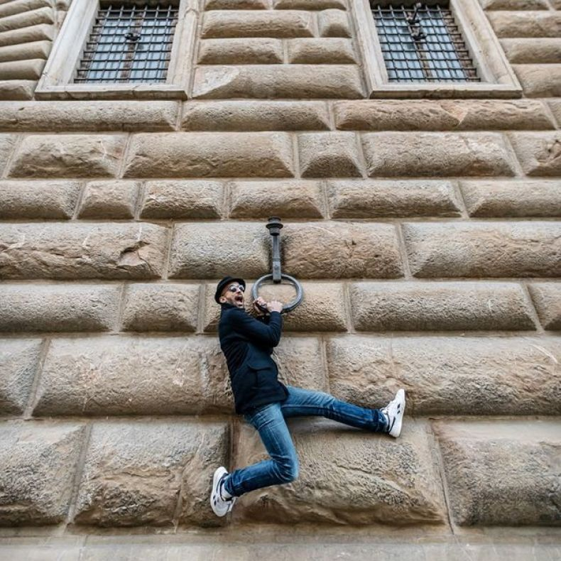JR hanging from the Palazzo Strozzi in Florence