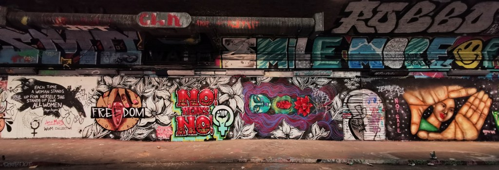 Long mural in the leake street tunnel in support of safer street and spaces for women