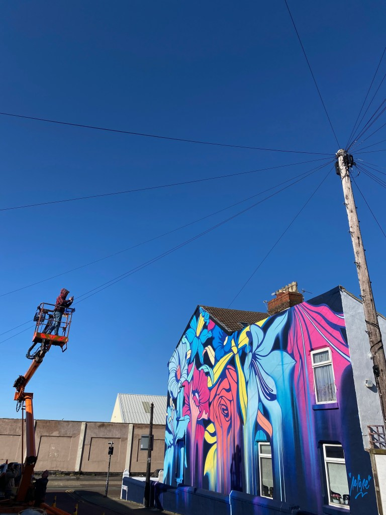 Nerone takes a picture of his completed mural in New Brighton