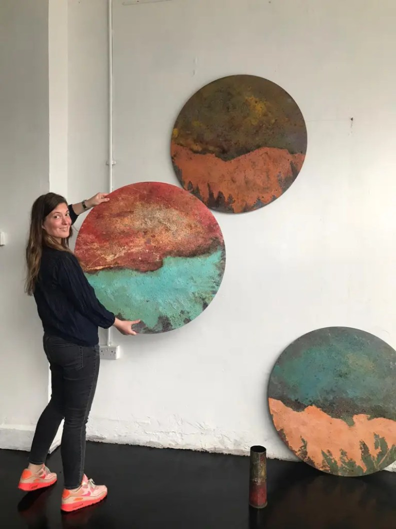 Paintings by Sam Peacock being hung at the Kahn Gallery