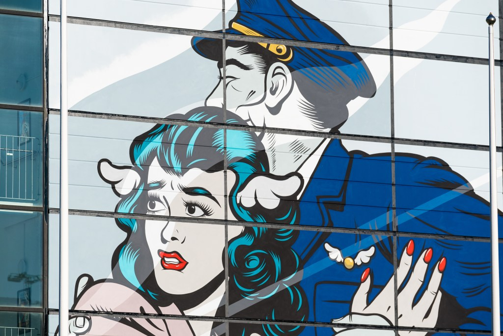 Embrace for landing the mural by D*face at Gothenburg-Landvetter airport