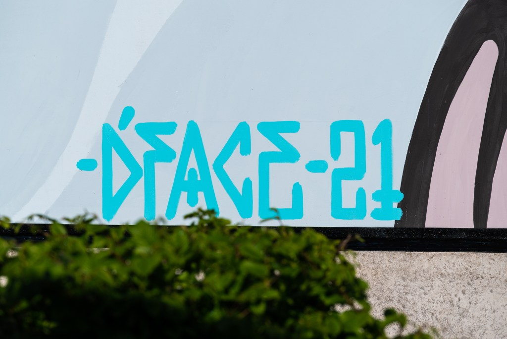 Signature by D*face on his mural at the Gothenburg-Lanvetter airport