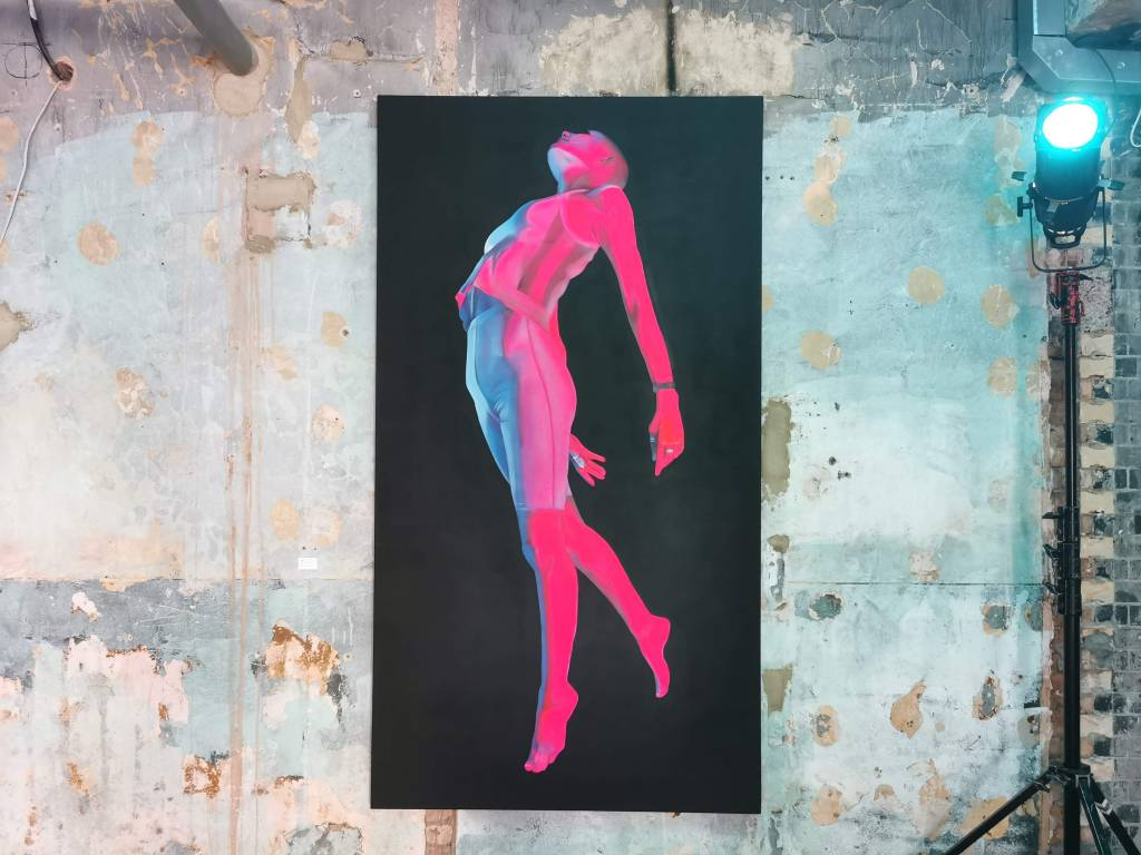 A woman rises to the sky. One of the paintings by David Speed at his Light of Life exhibition