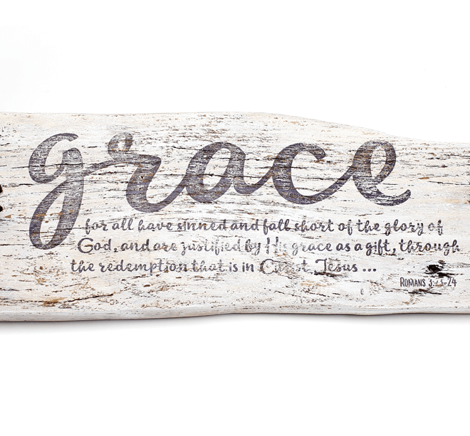 "salvaged wood sculpture with the word ""Grace"" and a Bible verse imprinted on it"
