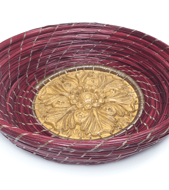Image of a red, hand-woven pine straw basket by Patti Jones