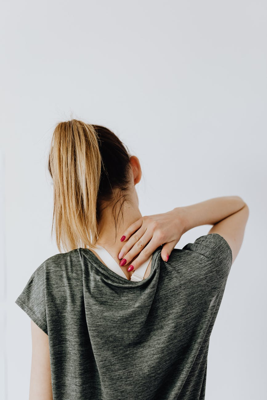 back view of a woman having a neck pain