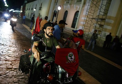 Caracas, Venezuela: a Che Guevara lookalike rides his motorcycle at a gathering in support of President-elect Nicolás Maduro