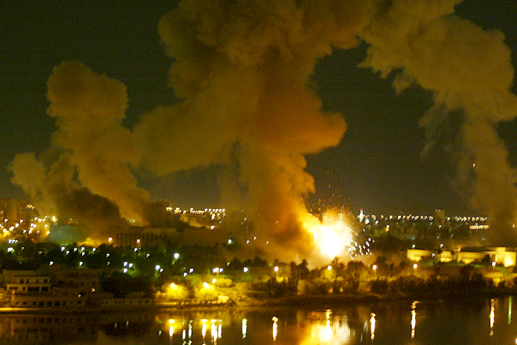 BUILDING EXPLODES IN PRESIDENTIAL PALACE COMPOUND DURING AIR RAID ON BAGHDAD.