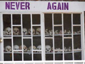 Never_Again_-_With_Display_of_Skulls_of_Victims_-_Courtyard_of_Genocide_Memorial_Church_-_Karongi-Kibuye_-_Western_Rwanda_-_02