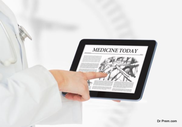 Doctor pointing on digital tablet
