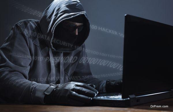 Hacker stealing data from a laptop