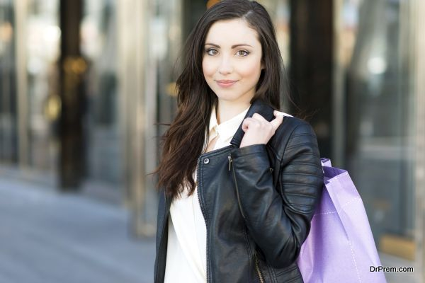 Beautiful woman with handbag walking on the street